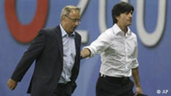 Germany's head coach Joachim Loew, right, and Austria's head coach Josef Hickersberger go into the tribunes after being sent off