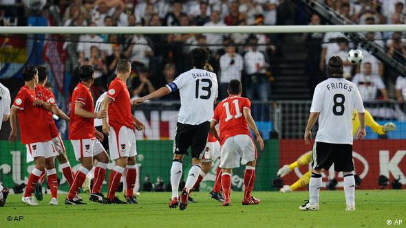 Germany's Michael Ballack, 13, scores the opening goal after shooting a free kick during the group B match between Austria and Germany in Vienna