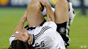 Germany's Torsten Frings sits on the field during the group B match between Austria and Germany in Vienna