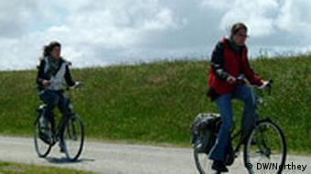 Two cyclists on a bike path