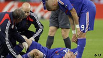 France's Franck Ribery lies on the pitch in pain