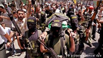Palestinian militants carrying the body of Moutaz Tafesh, an Islamic Jihad militant, as his funeral takes place in Gaza City in the Gaza Strip on 17 June 2008.