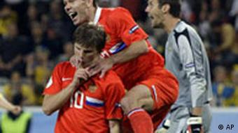 Russia's Andrei Arshavin, left, celebrates after scoring during the group D match between Russia and Sweden in Innsbruck