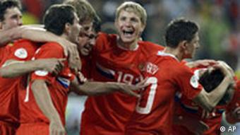 Russia's Andrei Arshavin, right, celebrates with fellow team members after scoring his side's second goal during the group D match between Russia and Sweden