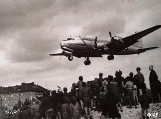 American Douglas C-54 transport plane approaching Berlin-Tempelhof Airport in 1948