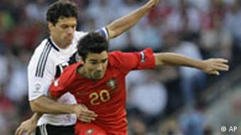 Germany's Michael Ballack, left, and Portugal's Deco challenge for the ball