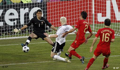 Germany's Bastian Schweinsteiger, second from left, scores the opening goal past Portuguese goalie Ricardo, left, during the quarterfinal match between Portugal and Germany in Basel