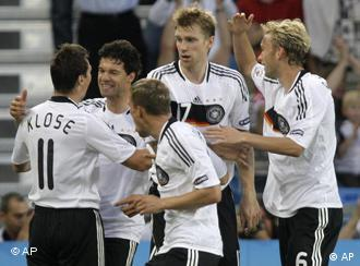 Germany's Simon Rolfes, Per Mertesacker, Lukas Podolski and Michael Ballack, from right, celebrate Miroslav Klose, left, scoring Germany's 2nd goal during the quarterfinal match between Portugal and Germany