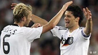 Germany's Michael Ballack, right, celebrates his side's 3-2 win over Portugal with teammate Simon Rolfes
