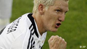 Bastian Schweinsteiger reacts after scoring during the quarterfinal match between Portugal and Germany at Euro 2008