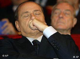 Berlusconi listens with his eyes closed