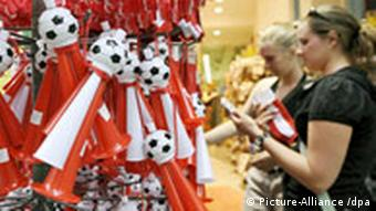 Two women shopping for soccer souvenirs