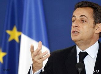 French President Nicolas Sarkozy gestures while speaking during a media conference after an EU summit in Brussels, Friday June 20, 2008. The European Union, facing an uphill battle to keep a key but stalled reform treaty alive, has given itself until October to come up with ideas for how to overcome the 'no' vote in an Irish referendum. (AP Photo/Michel Spingler)