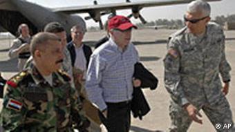 Senator John McCain with American and Iraqi military officers