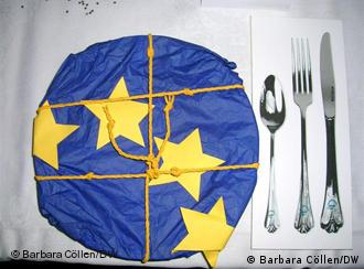 Plate with European flag motif and cutlery beside it