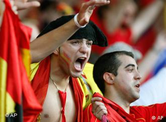 Spain's national soccer team supporters react during the live broadcast of the Euro 2008 European Soccer Championships quarterfinals match between Spain and Italy, which takes place in Vienna, at the Colon square of Madrid, June 22, 2008.
