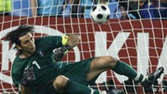 Italian goalie Gianluigi Buffon looks at the ball heading into the net as Spain's Cesc Fabregas, not visible, scores the decisive goal during the penalty shootout of the quarterfinal match between Spain and Italy in Vienna, Austria, Sunday, June 22, 2008, at the Euro 2008 European Soccer Championships in Austria and Switzerland. Spain won 4-2 following the shootout.