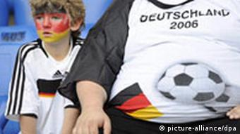 Two German fans sit in the stadium ahead of the EURO 2008 Quarter Final match between Portugal and Germany