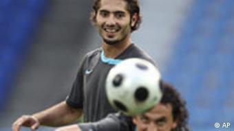 Turkey's Hamit Altintop, rear, and Tuncay Sanli play during a training session