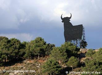 A bull sign stands in a Spanish landscape