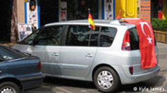 a car with Turkish and German flags on it