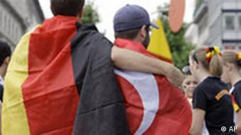Football fans with a German and a Turkish flag.