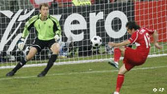 Turkey's Ugur Boral, right, scores the opening goal past Germany's Jens Lehmann