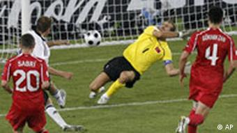 Germany's Philipp Lahm, center left, scores the decisive goal past Turkey's Rustu Recber