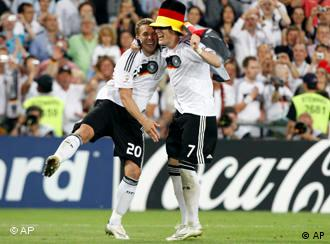 Bastian Schweinsteiger, right, celebrates with teammate Lukas Podolski after Germany's semifinal win against Turkey at Euro 2008
