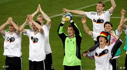 German players celebrate their 3-2 win at the end of the semifinal match between Germany and Turkey in Basel