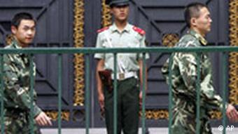 Chinese paramilitary police officers patrol outside the North Korean Embassy in Beijing Thursday, June 26, 2008. Developments on North Korea's long-delayed nuclear declaration were expected in Beijing Thursday, the deadline for the North to hand over an accounting of its nuclear program. (AP Photo/Greg Baker)
