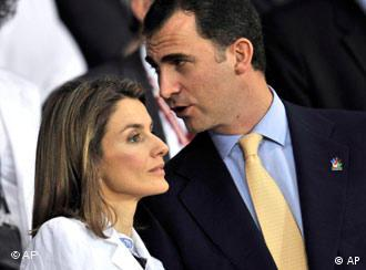 Spain's Prince Felipe, right, chats with his wife Princess Letizia