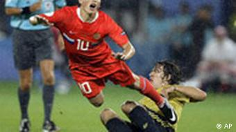 Russia's Andrei Arshavin, left, is tackled by Spain's Carles Puyol