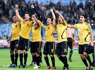 Spanish players celebrate after the semifinal match between Russia and Spain in Vienna
