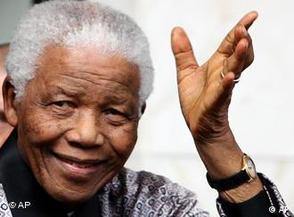 Former South African president Nelson Mandela waves as he leaves his hotel in London,Thursday, June 26, 2008. Mandela is in the UK to celebrate his 90th birthday which will see a concert in his honour at Hyde Park with the proceeds going to his 46664 charity. (AP Photo/Simon Dawson