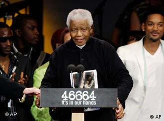 Former South African president Nelson Mandela, center on his 90th birthday in London.