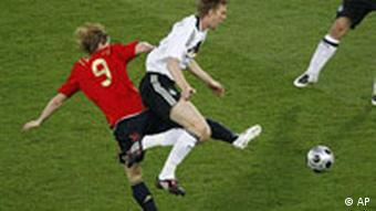 Spain's Fernando Torres, left, and Germany's Per Mertesacker challenge for the ball during the Euro 2008 final between Germany and Spain in the Ernst-Happel stadium in Vienna, Austria, Sunday, June 29, 2008, the last day of the European Soccer Championships in Austria and Switzerland.