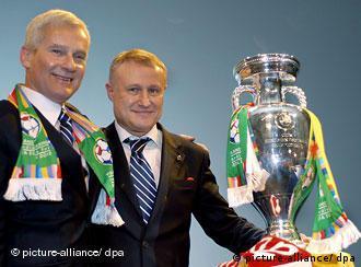 Football Association of Poland Michal Listkiewicz (L) and President of the Football Association of Ukraine Grygoriy Surkis (R) hold up the UEFA Euro Championship winners trophy