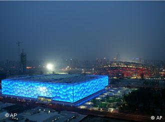 **ADVANCE FOR SUNDAY, JUNE 29--FILE** In this April 18, 2008 file photo, two Olympic venues, the National Aquatics Center, also known as the Water Cube, left, and the National Olympic Stadium, also known as the Bird's Nest, at right, are seen in Beijing. (AP Photo/Greg Baker, file)