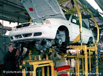 A car on a lift in a factory