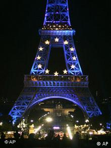 The Eiffel Tower is lit up in the colors of the European flag