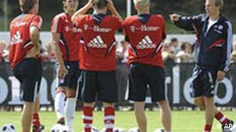 Bayern Munich during training with coach Juergen Klinsmann, right