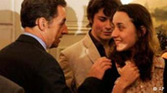 Nicolas Sarkozy with Betancourt's children in Paris