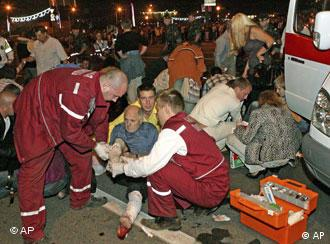 People receive first aid treatment after an explosion in downtown Minsk
