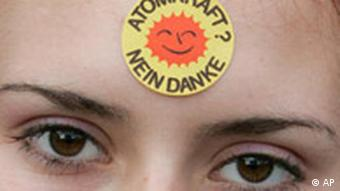 woman with anti-nuclear sticker on forehead