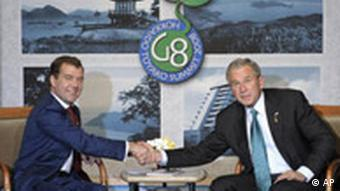 U.S. President George W. Bush, right, shakes hands with Russian President Dmitry Medvedev