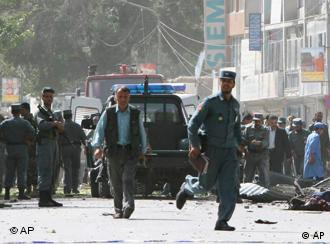 Afghan policemen at the site of the suicide attack in Kabul, Afghanistan, on Monday, July 07, 2008.