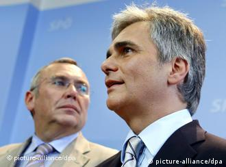 Austrian Federal Chancellor Alfred Gusenbauer (L) of the Social Democratic Party SPOe looks on as SPOe party leader Werner Faymann speaks during a press conference in Vienna