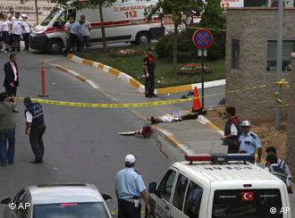 An unidentified man lies on the ground lifeless after an attack outside of the U.S. Consulate in Istanbul