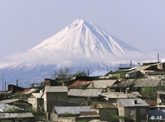 A view of Mount Ararat's peak with a village in the foreground